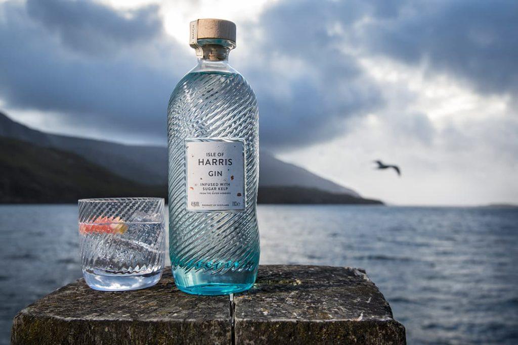 Hrris Gin bottle sitting on a rock on the island