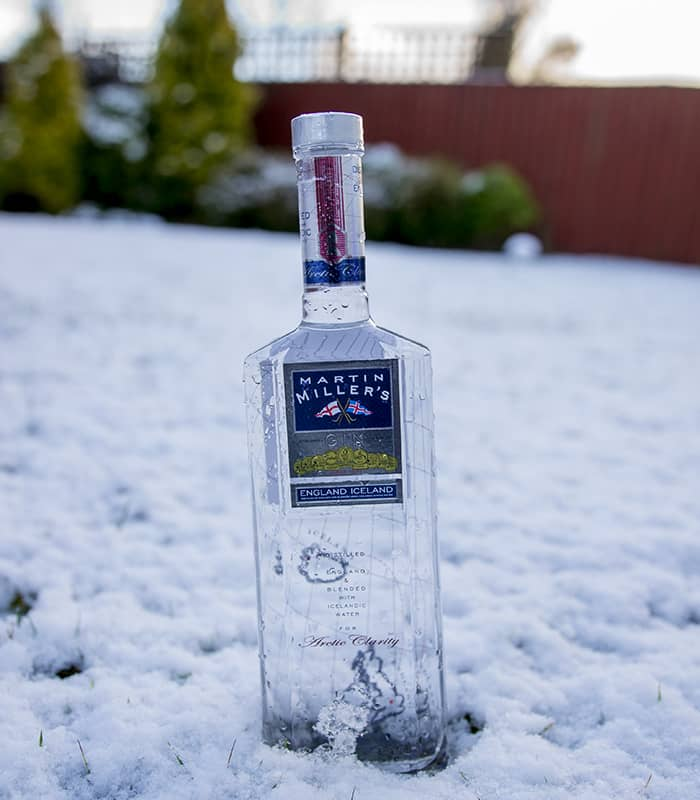 Martin Miller's Gin bottle wedged in snow