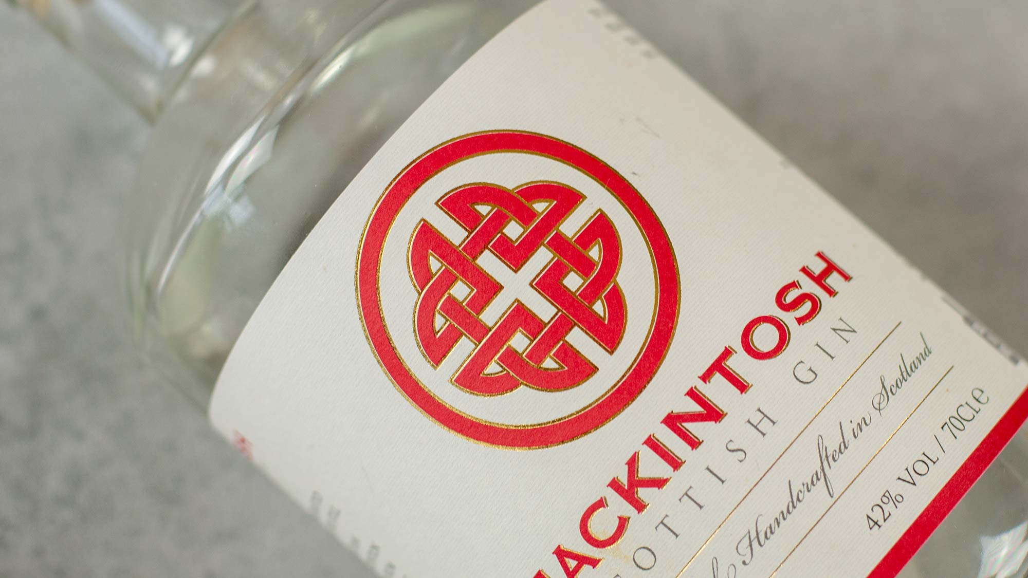 Mackintosh Gin bottle, turned 45 degree to show logo appearing as a heart-shape.