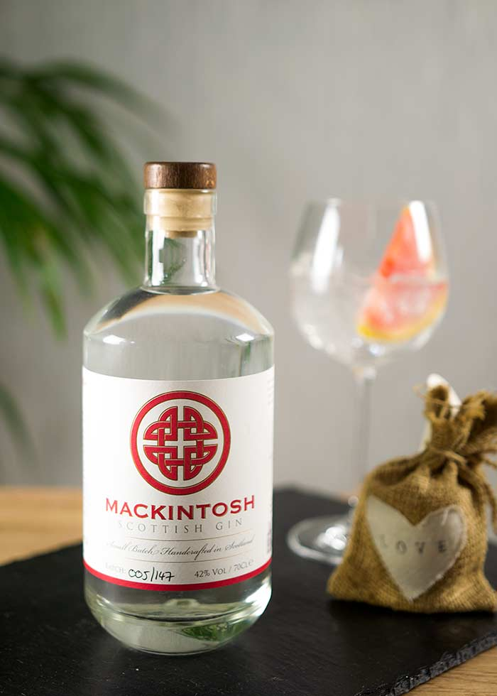 Mackintosh Gin perfect serve - gin and tonic, garnished with grapefruit wedge.