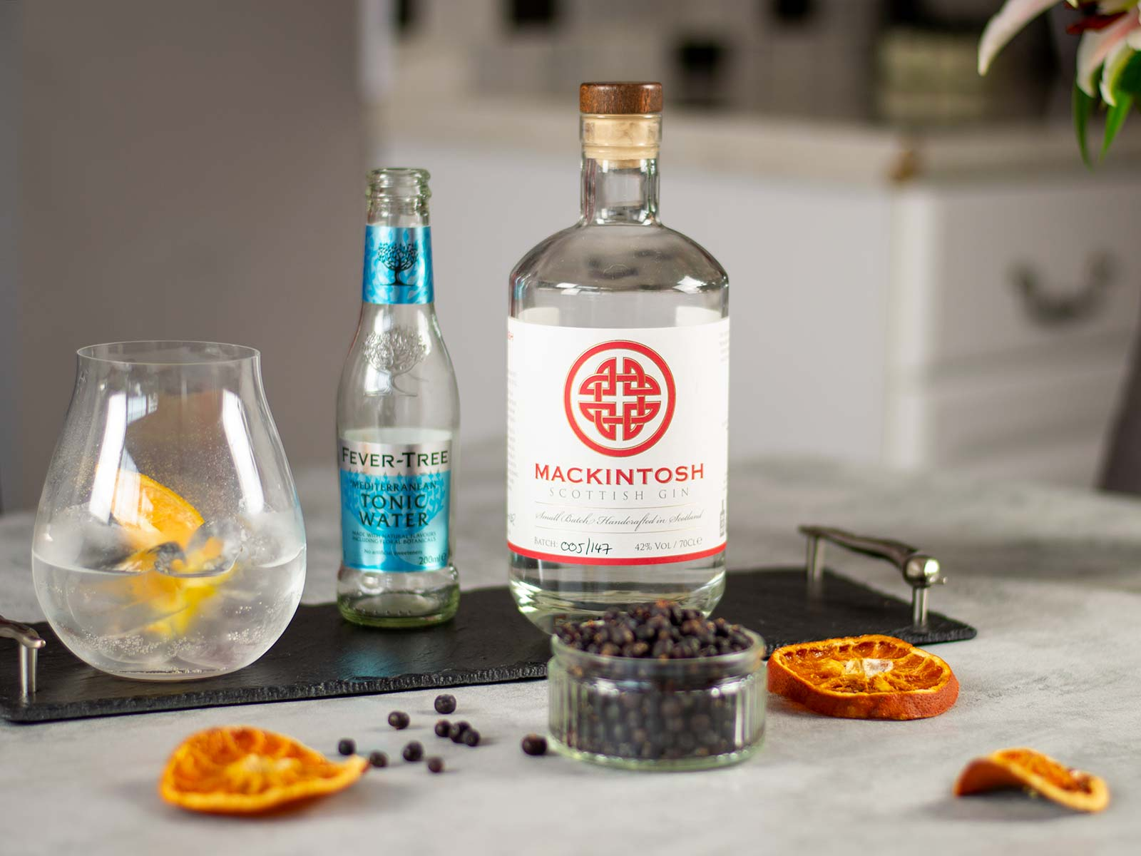 Mackintosh Gin bottle, Fever-Tree Mediterranean Tonic Water, and a gin and tonic.