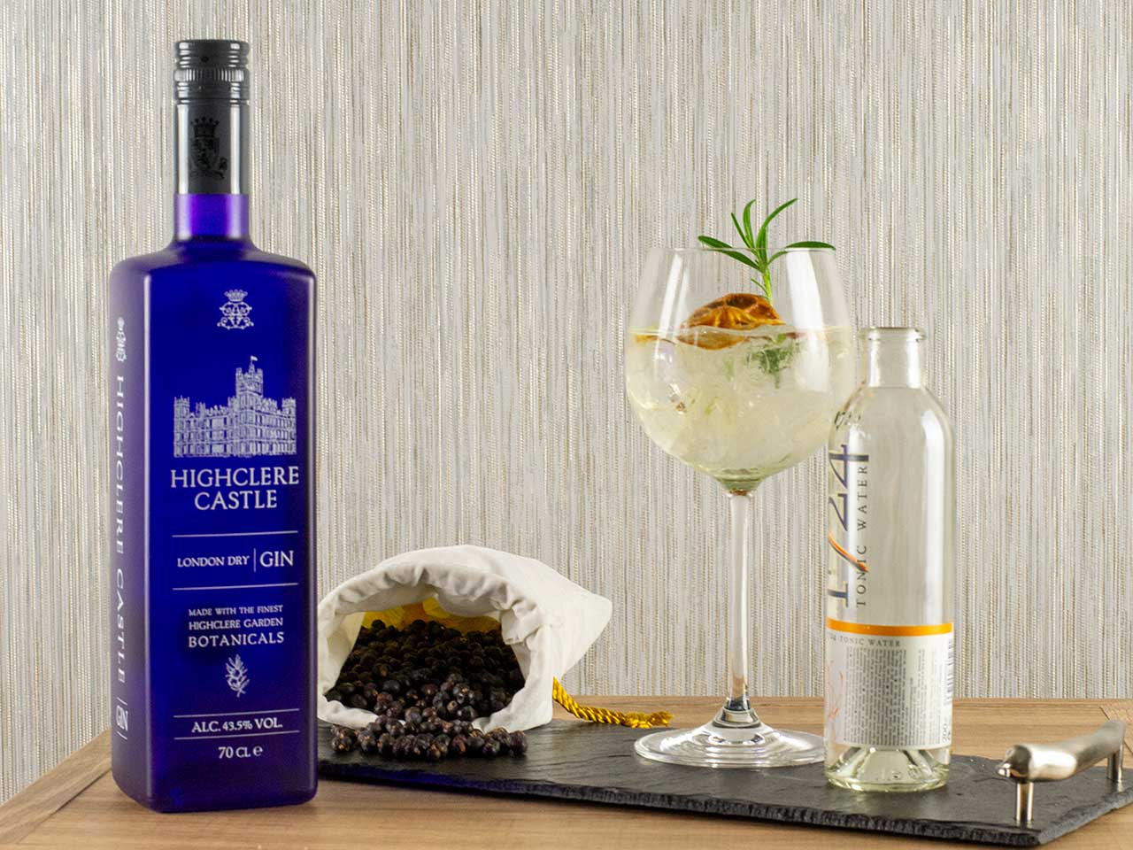 Highclere Castle Gin and tonc, garnished with dehydrated orange and rosemary.