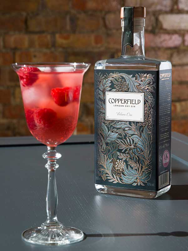 Copperfield Gin bottle and cocktail.