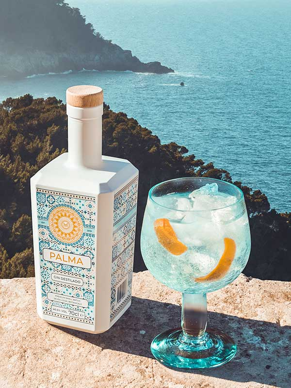 Palma Gin bottle with a sea view.