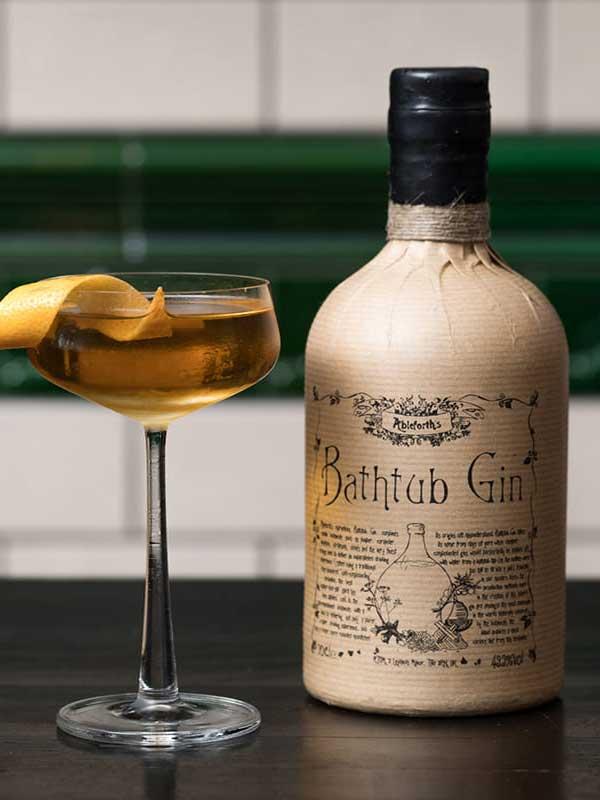Bathtub Gin bottle next to a cocktail.