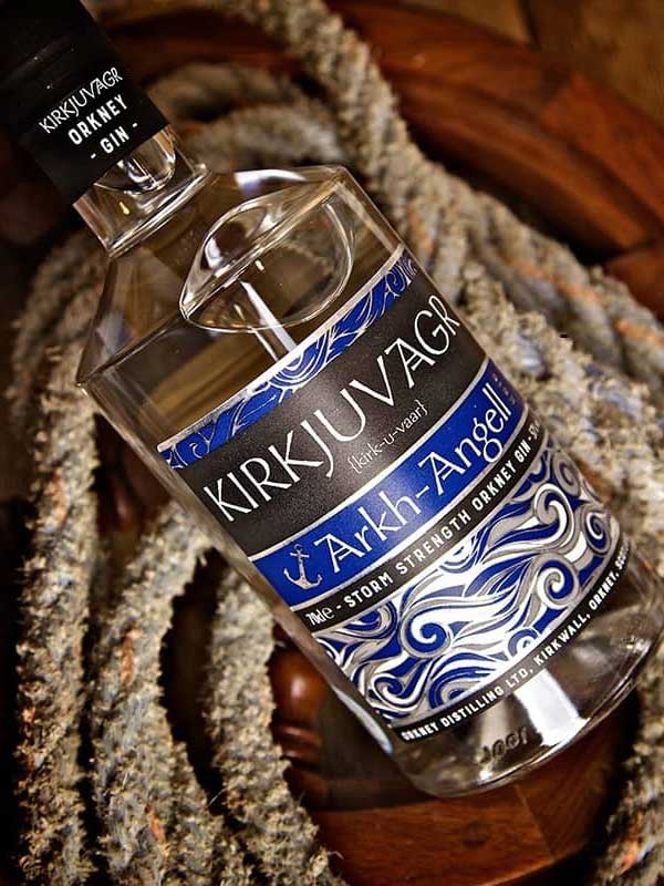 Kirkjuvagr Storm Gin bottle sitting on its side on top of a rope.