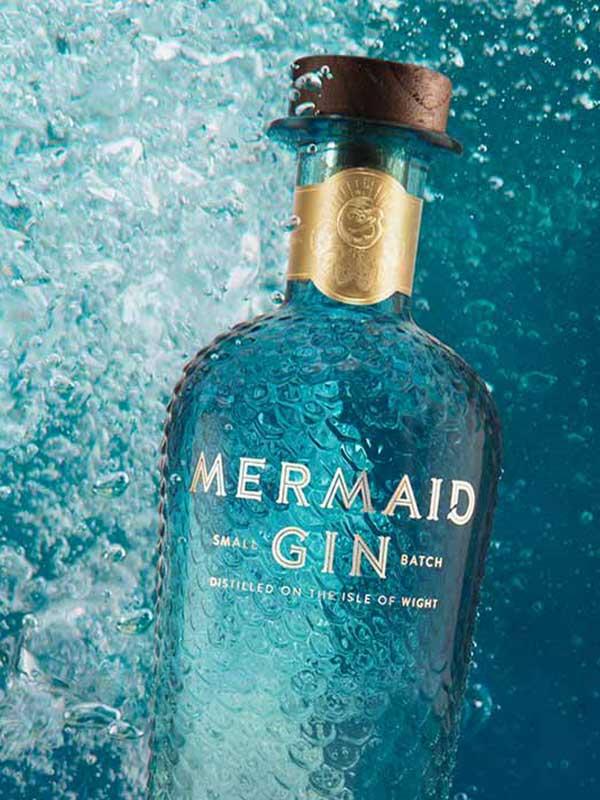 Mermaid Gin bottle underwater.
