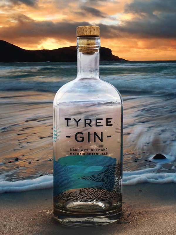 Tyree Gin bottle on a beach.